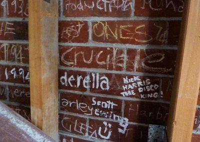 Graffiti exposed during demolition